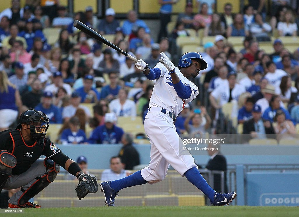 Dee Gordon #9 of the Los Angeles Dodgers hits a solo home run in the third inning against the Miami Marlins during the MLB game at Dodger Stadium on May 11, 2013 in Los Angeles, California.