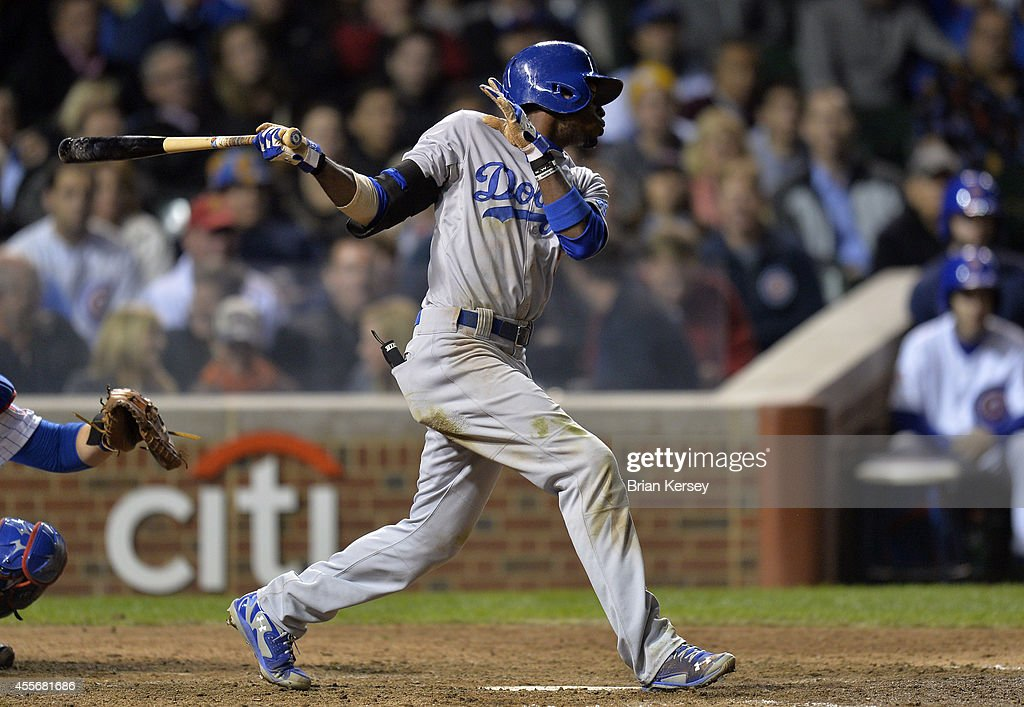 Dee Gordon #9 of the Los Angeles Dodgers hits an RBI double, scoring teammate Andre Ethier during the seventh inning against the Chicago Cubs at Wrigley Field on September 18, 2014 in Chicago, Illinois.