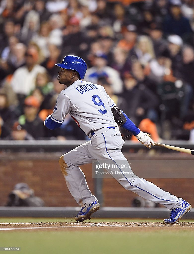 <a gi-track='captionPersonalityLinkClicked' href=/galleries/search?phrase=Dee+Gordon&family=editorial&specificpeople=7091343 ng-click='$event.stopPropagation()'>Dee Gordon</a> #9 of the Los Angeles Dodgers hits an RBI triple scoring pitcher Paul Maholm #47 (not pictured) in the top of the six inning against the San Francisco Giants at AT&T Park on April 16, 2014 in San Francisco, California.