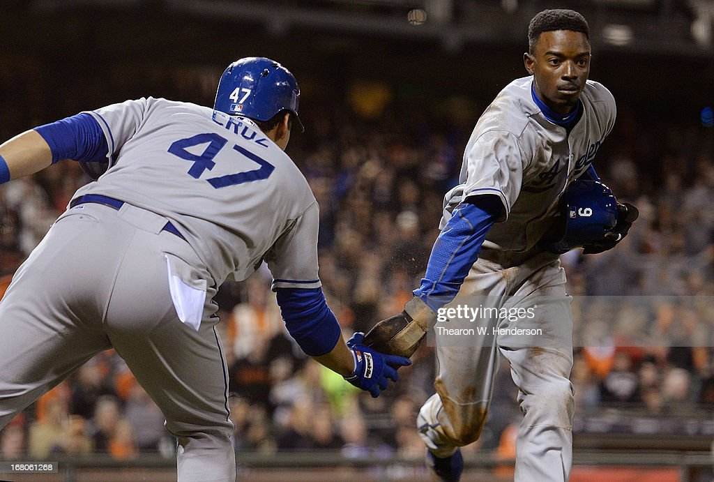 <a gi-track='captionPersonalityLinkClicked' href=/galleries/search?phrase=Dee+Gordon&family=editorial&specificpeople=7091343 ng-click='$event.stopPropagation()'>Dee Gordon</a> #9 of the Los Angeles Dodgers is congratulated by <a gi-track='captionPersonalityLinkClicked' href=/galleries/search?phrase=Luis+Cruz+-+Baseball+Shortstop&family=editorial&specificpeople=9658185 ng-click='$event.stopPropagation()'>Luis Cruz</a> #47 after Gordon scored against the San Francisco Giants in the seventh inning at AT&T Park on May 4, 2013 in San Francisco, California.