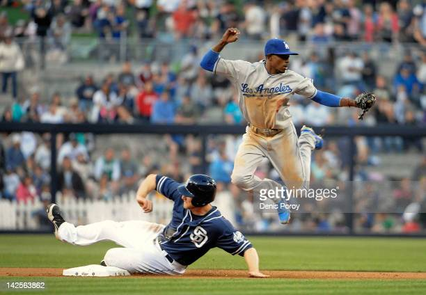 Dee Gordon of the Los Angeles Dodgers jumps over Chase Headley of the San Diego Padres after getting the force out during the fifth inning Petco Park...