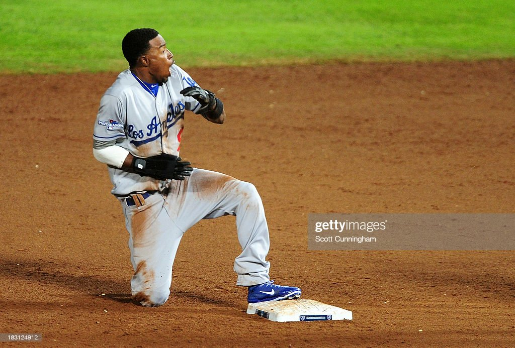 <a gi-track='captionPersonalityLinkClicked' href=/galleries/search?phrase=Dee+Gordon&family=editorial&specificpeople=7091343 ng-click='$event.stopPropagation()'>Dee Gordon</a> #9 of the Los Angeles Dodgers reacts after being thrown out at second in the ninth inning against the Atlanta Braves during Game Two of the National League Division Series at Turner Field on October 4, 2013 in Atlanta, Georgia.