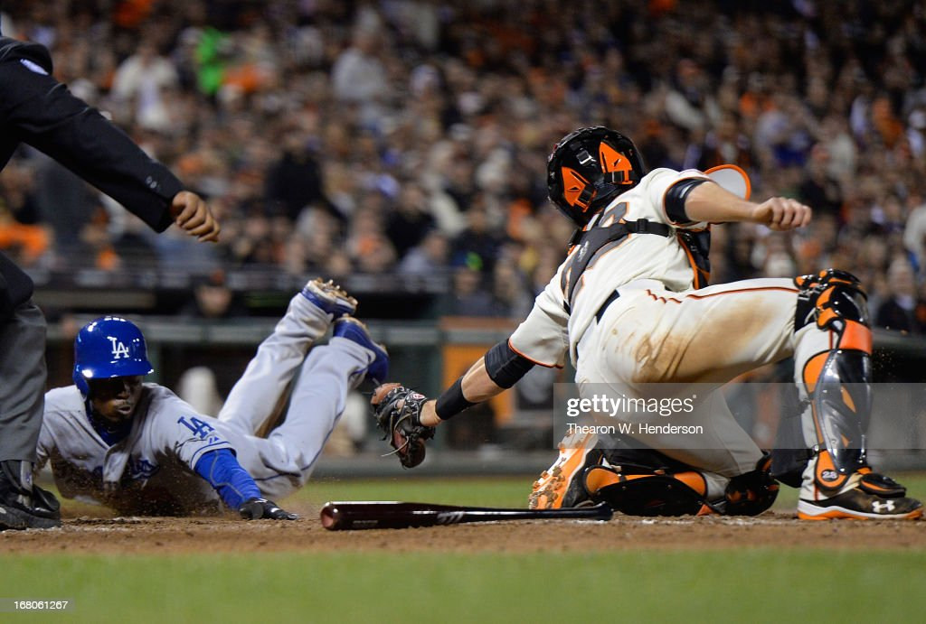 <a gi-track='captionPersonalityLinkClicked' href=/galleries/search?phrase=Dee+Gordon&family=editorial&specificpeople=7091343 ng-click='$event.stopPropagation()'>Dee Gordon</a> #9 of the Los Angeles Dodgers scores, diving into home, avoiding the tag of <a gi-track='captionPersonalityLinkClicked' href=/galleries/search?phrase=Buster+Posey&family=editorial&specificpeople=4896435 ng-click='$event.stopPropagation()'>Buster Posey</a> #28 of the San Francisco Giants in the seventh inning at AT&T Park on May 4, 2013 in San Francisco, California.