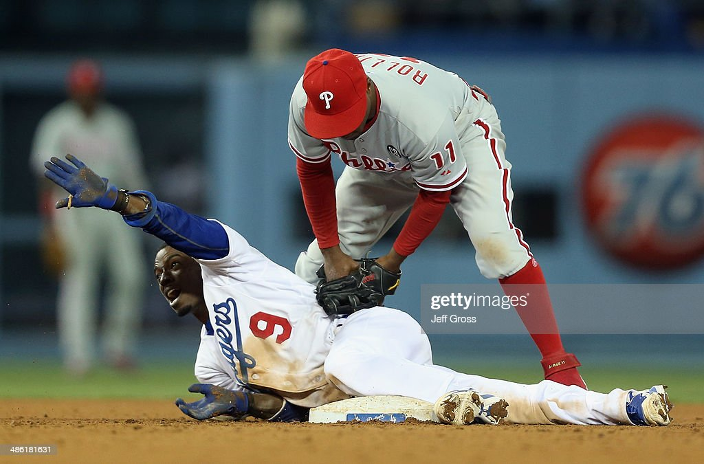 <a gi-track='captionPersonalityLinkClicked' href=/galleries/search?phrase=Dee+Gordon&family=editorial&specificpeople=7091343 ng-click='$event.stopPropagation()'>Dee Gordon</a> #9 of the Los Angeles Dodgers slides safely past the tag of shortstop <a gi-track='captionPersonalityLinkClicked' href=/galleries/search?phrase=Jimmy+Rollins&family=editorial&specificpeople=204478 ng-click='$event.stopPropagation()'>Jimmy Rollins</a> #11 of the Philadelphia Phillies for a double in the seventh inning at Dodger Stadium on April 22, 2014 in Los Angeles, California.