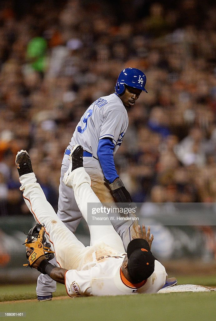 <a gi-track='captionPersonalityLinkClicked' href=/galleries/search?phrase=Dee+Gordon&family=editorial&specificpeople=7091343 ng-click='$event.stopPropagation()'>Dee Gordon</a> #9 of the Los Angeles Dodgers steals third base and watches <a gi-track='captionPersonalityLinkClicked' href=/galleries/search?phrase=Pablo+Sandoval&family=editorial&specificpeople=803207 ng-click='$event.stopPropagation()'>Pablo Sandoval</a> #48 of the San Francisco Giants fall on his back after taking the throw down in the seventh inning at AT&T Park on May 4, 2013 in San Francisco, California. Gordon later scored in the inning to put the Dodgers ahead 9-8.