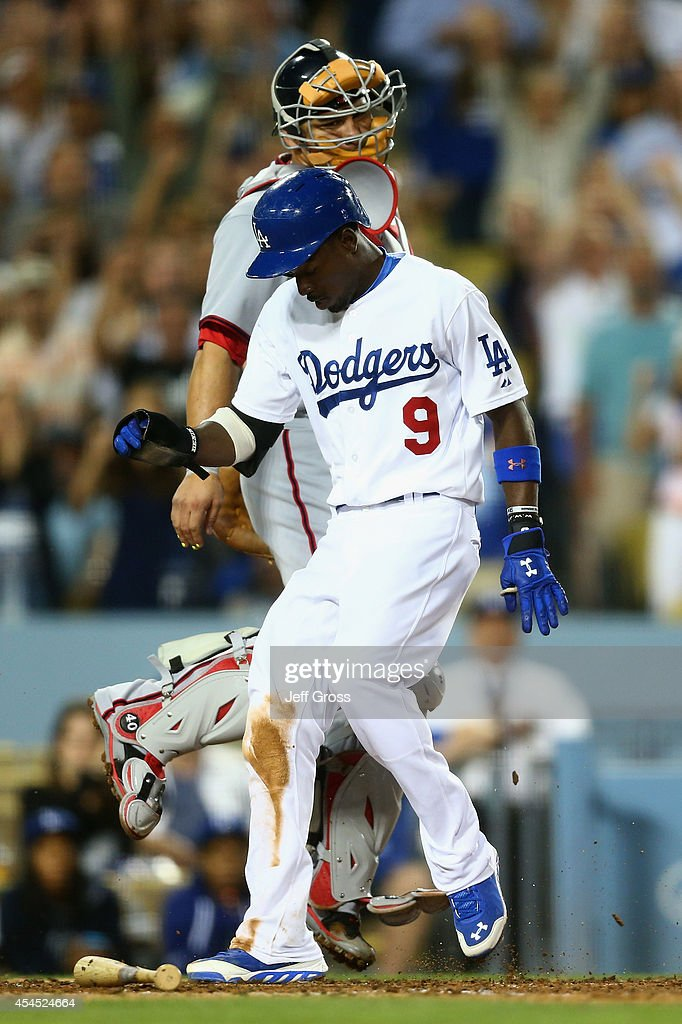 <a gi-track='captionPersonalityLinkClicked' href=/galleries/search?phrase=Dee+Gordon&family=editorial&specificpeople=7091343 ng-click='$event.stopPropagation()'>Dee Gordon</a> #9 of the Los Angeles Dodgers steps on home plate and scores a run in front of catcher <a gi-track='captionPersonalityLinkClicked' href=/galleries/search?phrase=Wilson+Ramos&family=editorial&specificpeople=4866956 ng-click='$event.stopPropagation()'>Wilson Ramos</a> #40 of the Washington Nationals in the fifth inning at Dodger Stadium on September 2, 2014 in Los Angeles, California.