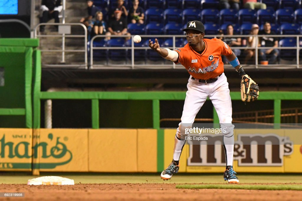 Dee Gordon #9 of the Miami Marlins bobbles a ground ball during the sixth inning against the Arizona Diamondbacks at Marlins Park on June 4, 2017 in Miami, Florida.