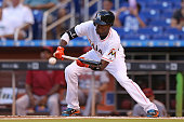 Dee Gordon of the Miami Marlins bunts during the first inning of the game against the Arizona Diamondbacks at Marlins Park on May 19 2015 in Miami...