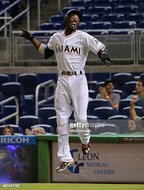 Dee Gordon of the Miami Marlins celebrates after scoring during a a game against the Milwaukee Brewers at Marlins Park on September 9 2015 in Miami...