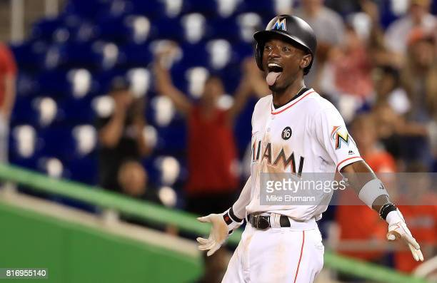 Dee Gordon of the Miami Marlins celebrates hitting a bases loaded walk off single in the 11th inning during a game against the Philadelphia Phillies...