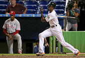 Dee Gordon of the Miami Marlins hits a walkoff double in the 11th inning during a game against the Philadelphia Phillies at Marlins Park on September...