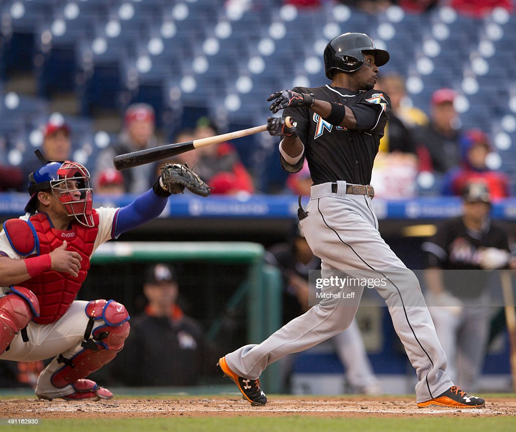 Dee Gordon of the Miami Marlins hits an RBI single in the top of the second inning against the Philadelphia Phillies on October 3 2015 at Citizens...