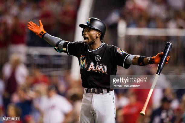 Dee Gordon of the Miami Marlins reacts after he struck out swinging in the seventh inning during a game against the Washington Nationals at Nationals...
