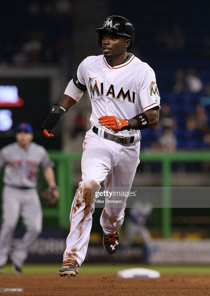 Dee Gordon of the Miami Marlins rounds second during a game against the New York Mets at Marlins Park on April 28 2015 in Miami Florida