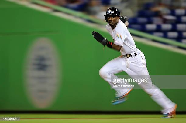 Dee Gordon of the Miami Marlins runs to second during a game against the Philadelphia Phillies at Marlins Park on September 22 2015 in Miami Florida