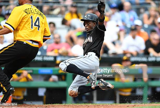 Dee Gordon of the Miami Marlins scores on after a wild pitch by Ryan Vogelsong of the Pittsburgh Pirates during the fourth inning on August 21 2016...