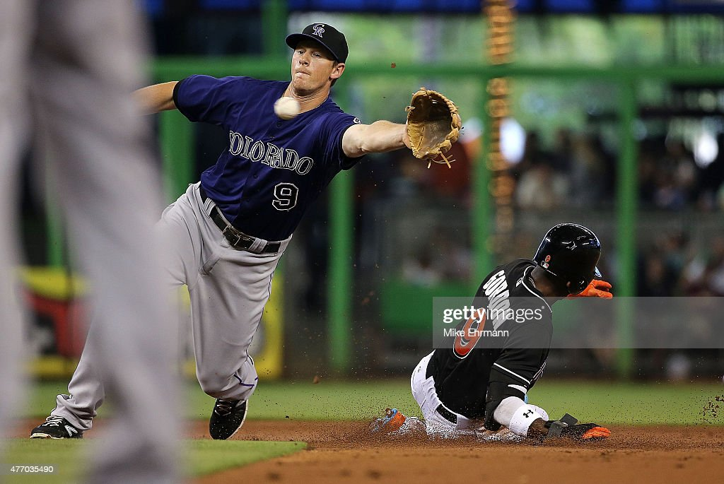 <a gi-track='captionPersonalityLinkClicked' href=/galleries/search?phrase=Dee+Gordon&family=editorial&specificpeople=7091343 ng-click='$event.stopPropagation()'>Dee Gordon</a> #9 of the Miami Marlins steals second as <a gi-track='captionPersonalityLinkClicked' href=/galleries/search?phrase=DJ+LeMahieu&family=editorial&specificpeople=5940806 ng-click='$event.stopPropagation()'>DJ LeMahieu</a> #9 of the Colorado Rockies fields the throw during a game at Marlins Park on June 13, 2015 in Miami, Florida.