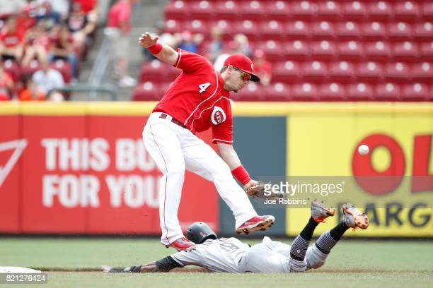 Dee Gordon of the Miami Marlins steals second base ahead of the throw to Scooter Gennett of the Cincinnati Reds in the first inning of a game at...