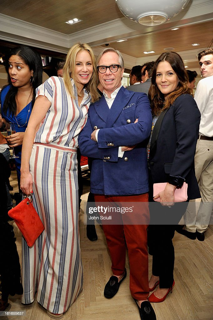 Dee Hilfiger, fashion designer Tommy Hilfiger and actress Drew Barrymore attend Tommy Hilfiger New West Coast Flagship Opening on Robertson Boulevard on February 13, 2013 in West Hollywood, California.