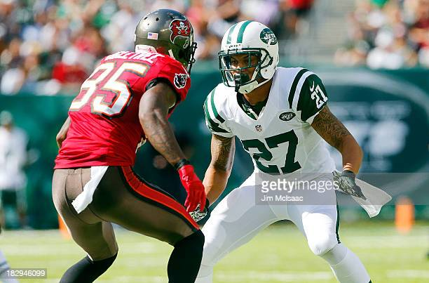 Dee Milliner of the New York Jets in action against Kevin Ogletree of the Tampa Bay Buccaneers on September 8 2013 at MetLife Stadium in East...