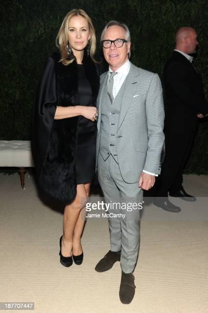 Dee Ocleppo and designerTommy Hilfiger attend CFDA and Vogue 2013 Fashion Fund Finalists Celebration at Spring Studios on November 11 2013 in New...