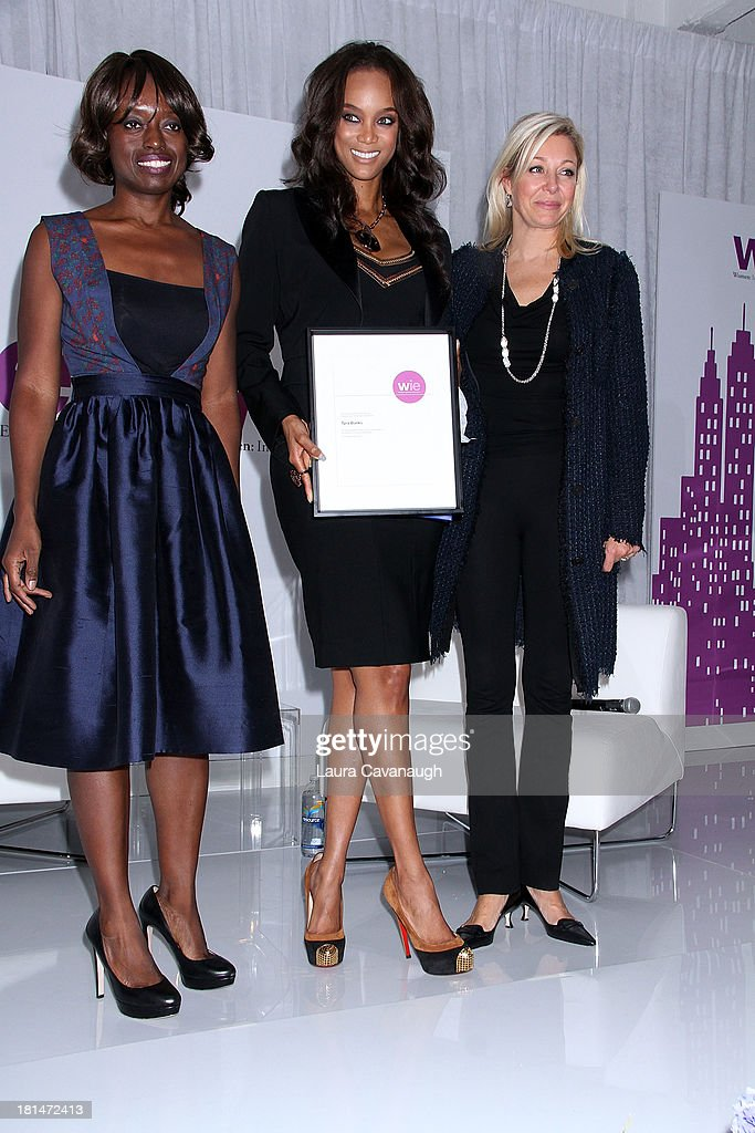 Dee Poku, Tyra Banks and Nadja Swarovski attend day 2 of the 4th Annual WIE Symposium at Center 548 on September 21, 2013 in New York City.