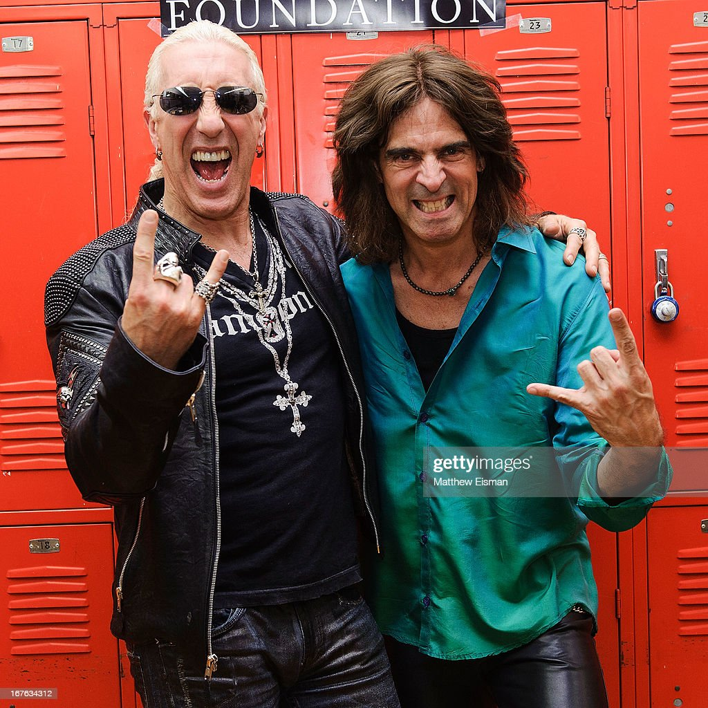 Dee Snider of the band Twisted Sister (L) and Electrify Your Music Foundation Founder/ electric violinist Mark Wood pose for a photo backstage at the Electrify Your Music Foundation launch event at Brooklyn Technical High School Theater on April 26, 2013 in the Brooklyn borough of New York City.