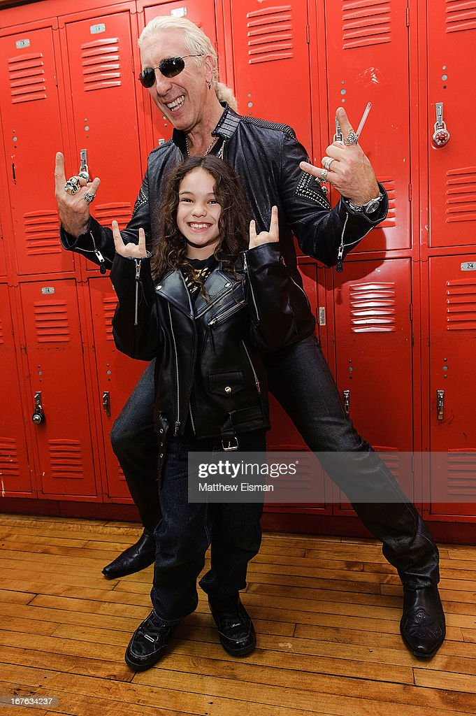 <a gi-track='captionPersonalityLinkClicked' href=/galleries/search?phrase=Dee+Snider&family=editorial&specificpeople=239139 ng-click='$event.stopPropagation()'>Dee Snider</a> of the band Twisted Sister poses with a fan for a photo backstage at the Electrify Your Music Foundation launch event at Brooklyn Technical High School Theater on April 26, 2013 in the Brooklyn borough of New York City.