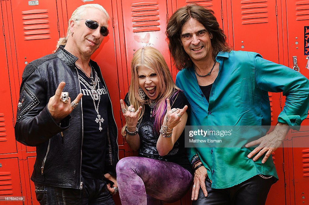 Dee Snider of the band Twisted Sister, singer Laura Kaye and Electrify Your Music Foundation Founder/ electric violinist Mark Wood pose for a photo backstage at the Electrify Your Music Foundation launch event at Brooklyn Technical High School Theater on April 26, 2013 in the Brooklyn borough of New York City.