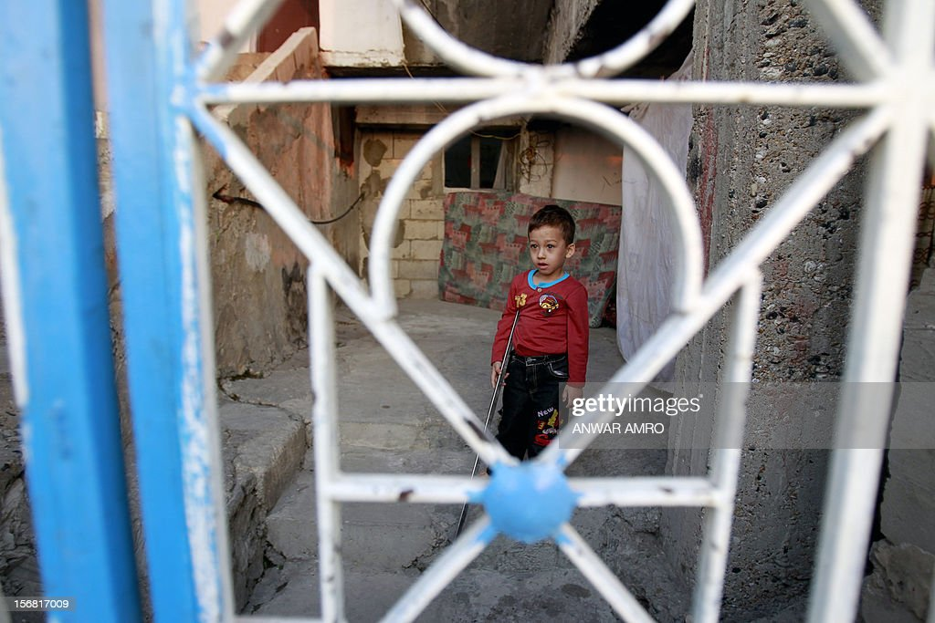 Deeb, a two-year-old Syrian refugee who arrived in Lebanon with his parents more than a year ago, stands outside the house his family is staying in on November 20, 2012 in the northern Lebanese town of Halba. Syrian refugees in Lebanon are demanding the creation of a camp like in Turkey and Jordan, but the Lebanese government and the United Nations reject the idea.