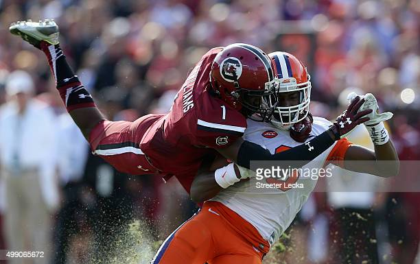 Deebo Samuel of the South Carolina Gamecocks tackles Deon Cain of the Clemson Tigers during their game at WilliamsBrice Stadium on November 28 2015...