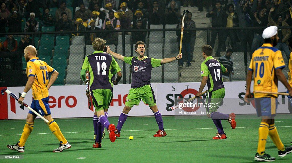 Deecke Oskar of Delhi Waveriders celebrates after scoring the first goal during the first match of Hockey India League against Punjab Warriors at Major Dhyan Chand Stadium on January 14, 2013 in New Delhi, India. Hockey India League is a professional league for field hockey competition comprising five franchisee-based teams consisting of players from India and around the world. The entire event takes place on home and away basis culminating into multi header playoffs.