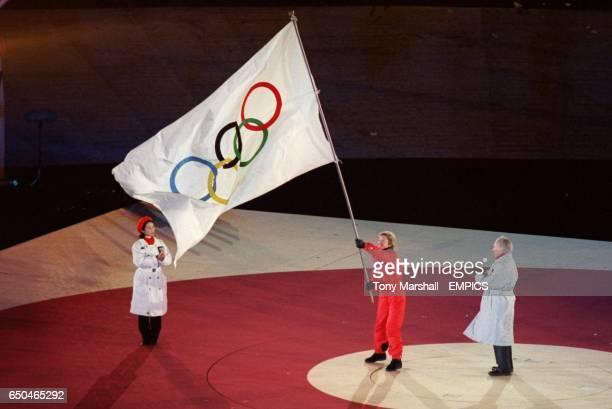 Deedee Corradini Major of Salt Lake City with the Olympic flag