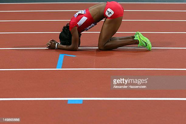 DeeDee Trotter of the United States celebrates winning bronze in the Women's 400m Final on Day 9 of the London 2012 Olympic Games at the Olympic...