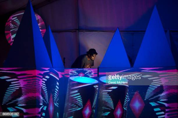 A deejay is seen in the Art Studios tent as music fans camp out at the Empire Polo Club on the eve of the 2017 Coachella Valley Music And Arts...
