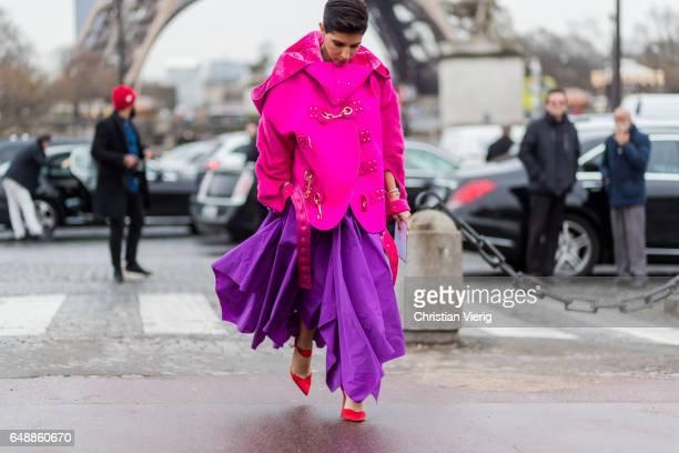 Deena Aljuhani Abdulaziz wearing a pink jacket pruple dress outside Hermes on March 6 2017 in Paris France
