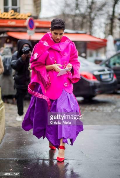 Deena Aljuhani Abdulaziz wearing a pink jacket purple skirt outside Giambattista Valli on March 6 2017 in Paris France