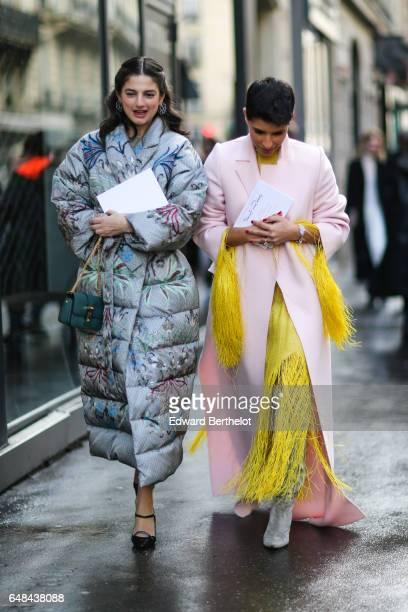 Deena Aljuhani Abdulaziz wears a pink coat and a yellow fringed dress outside the Valentino show during Paris Fashion Week Womenswear Fall/Winter...