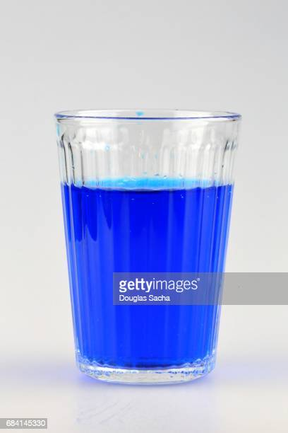Deep blue cocktail beverage in a clear serving glass