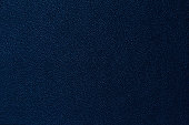 Seamless deep blue leather texture background surface closeup