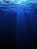 Underwater scene with light rays. 3D CG element.