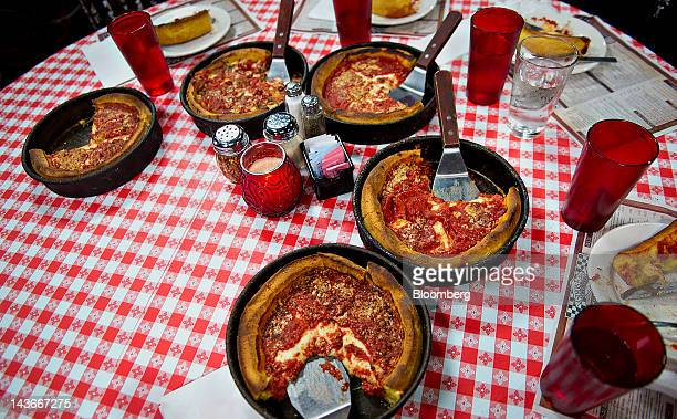 Deep dish pizza sits on a table at Gino's East restaurant in Chicago Illinois US on Wednesday April 18 2012 US restaurantindustry sales for a typical...