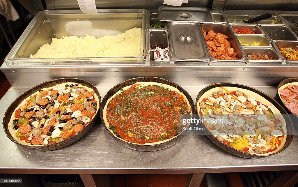 Deep dish pizzas are prepared at Connie's Pizza on March 6, 2008 in Chicago, Illinois. The cost of flour, a key ingredient in making pizza dough, has more than doubled in the past year because of high wheat prices caused by strong worldwide demand and increased price speculation. Connie's Pizza makes between 10 to 20 thousand pizzas each week.