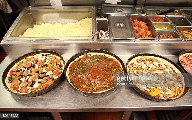 Deep dish pizzas are prepared at Connie's Pizza on March 6 2008 in Chicago Illinois The cost of flour a key ingredient in making pizza dough has more...