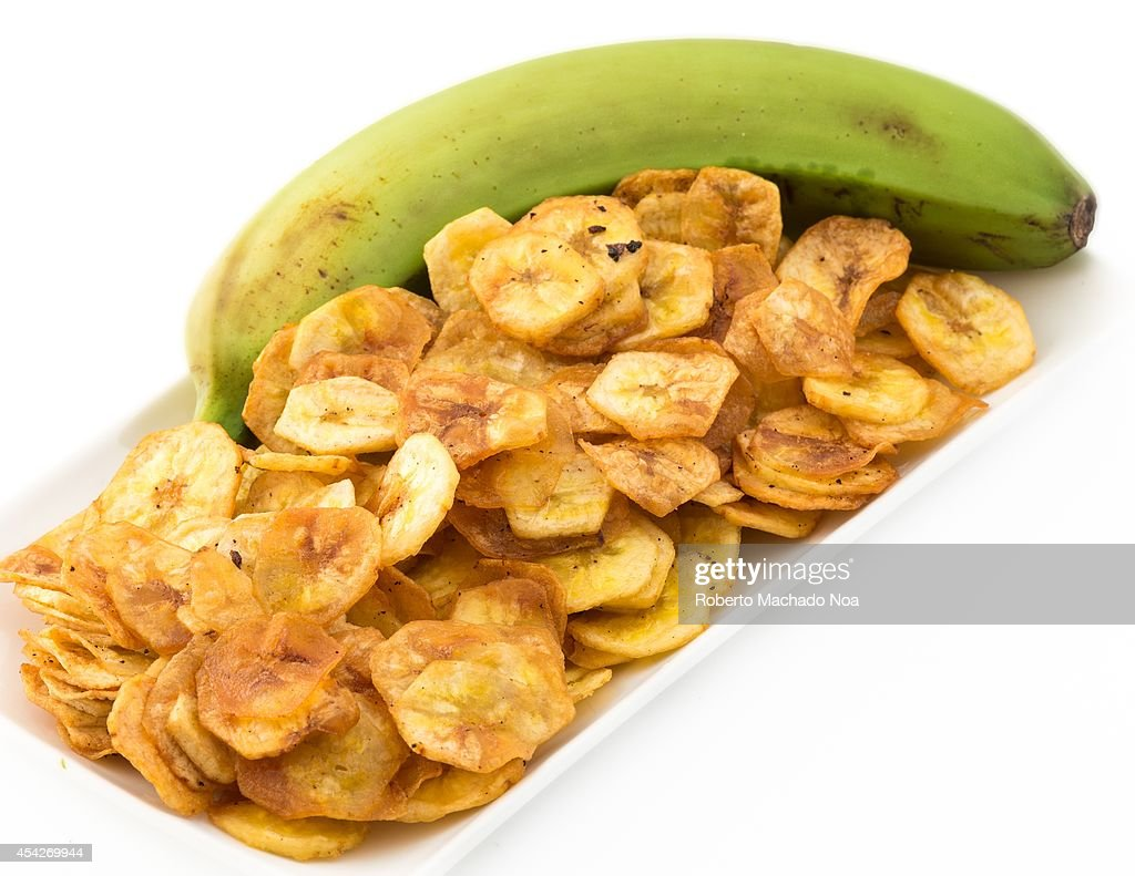 Deep fried salty green banana chips served in a white plate