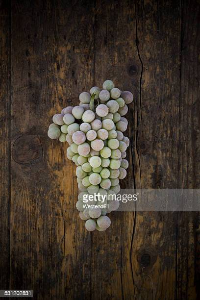 Deep frozen grapes on wood