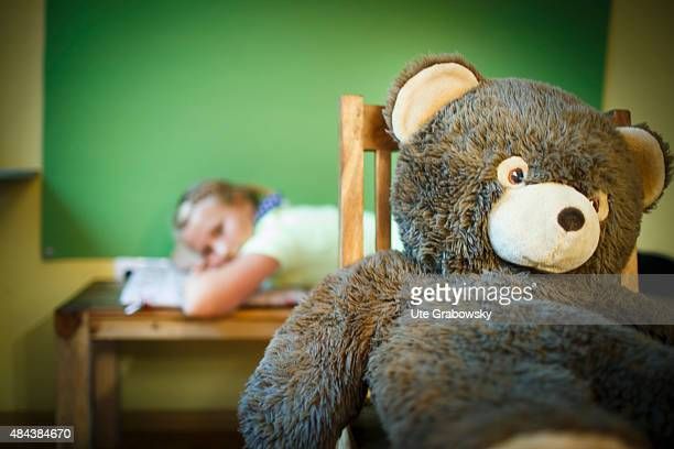 Deep frustrated eleven years old girl with a huge teddybear on August 10 2015 in Bonn Germany
