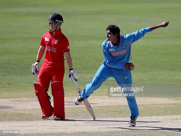 Deepak Hooda of India bowls during the ICC U19 Cricket World Cup 2014 Quarter Final match between England and India at the Dubai Sports City Cricket...