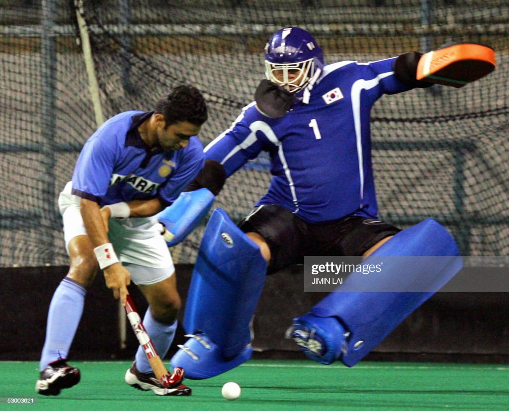 Deepak Thakur of India gets a full on charge from Korean goalkeeper Ko Dong Sik during the match between India and Korea at the Sultan Azlan Shah Cup...