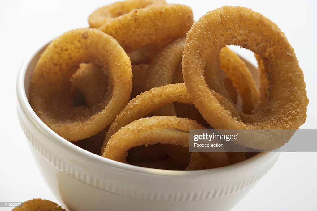 Deep-fried onion rings in white bowl